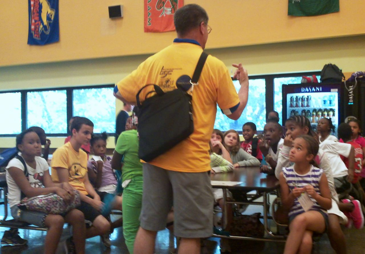 Coach Mark and students in the cafeteria