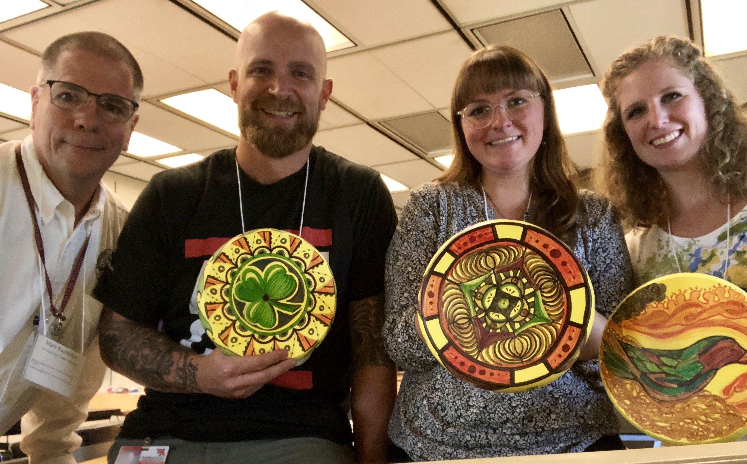 Mark Rauterkus and some teachers at Regional Arts Day with SKWIM disk artwork
